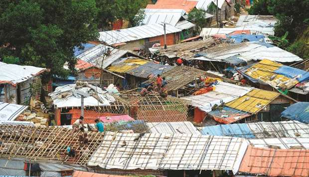 Rohingya refugees renovate makeshift houses at Kutupalong refugee camp in Ukhia district yesterday.