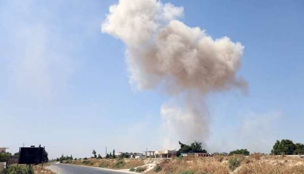 Smoke billows following a reported regime air strike on the eastern outskirts of Maaret al-Numan in