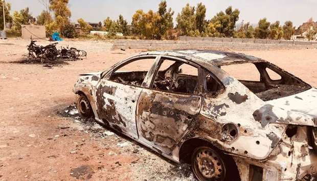 Vehicles destroyed in the rocket attack at a football stadium in Daquq