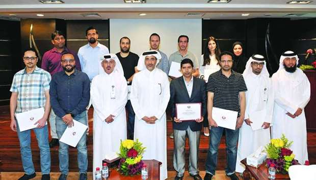 HE the Minister of Culture and Sports, Saleh bin Ghanem bin Nasser al-Ali, with the staff of the Inf