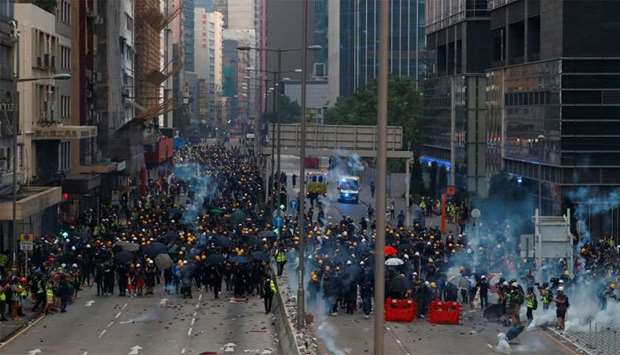 Protesters clash with police in Ngau Tau Kok in Hong Kong, China