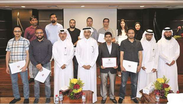 HE the Minister of Culture and Sports, Salah bin Ghanem bin Nasser al-Ali, with the staff of the Inf