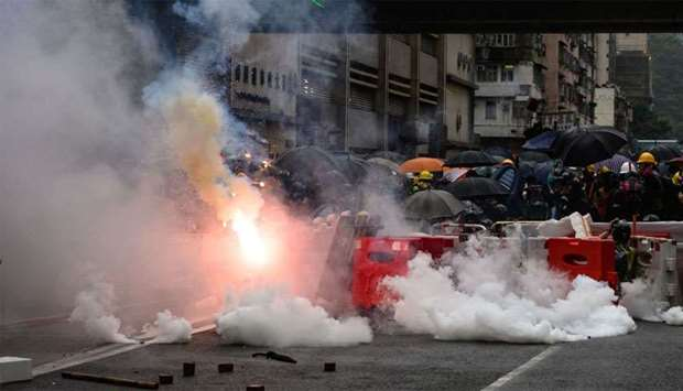 Police fire tear gas during a protest in Tsuen Wan district of Hong Kong