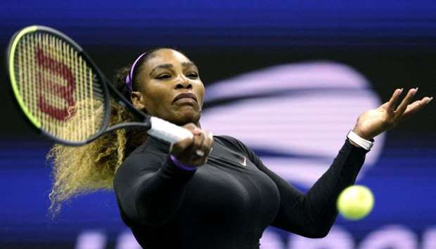 Serena Williams of the United Sates returns the ball to Maria Sharapova of Russi