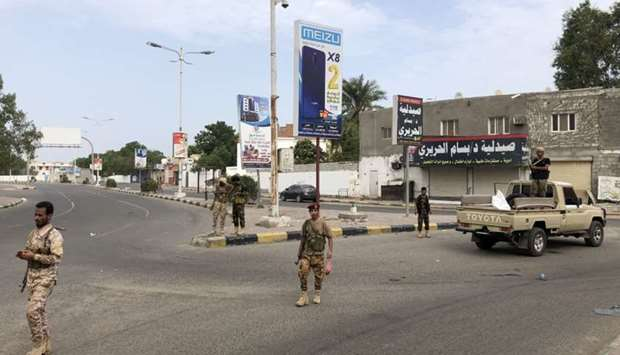 Fighters of the Security Belt Force patrol a street in an area near the Aden International airport