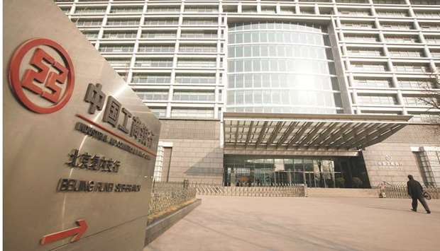 A man approaches the headquarters of the Industrial and Commercial Bank of China in Beijing. ICBC sa
