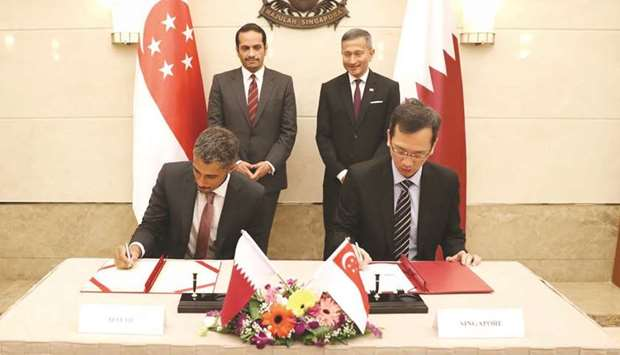 The dignitaries witnessed the signing of a memorandum of understanding yesterday in Singapore.