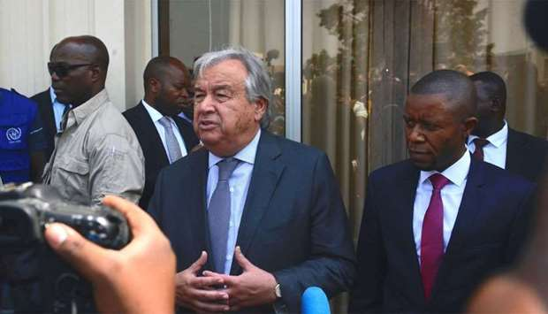 United Nations (UN) General Secretary Antonio Guterres (C,L) talks to medias next to North-Kivu regi