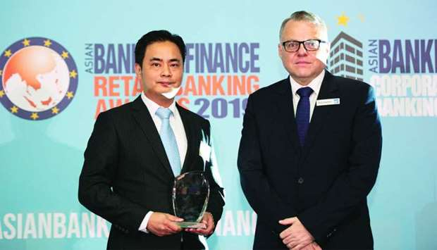 Doha Bank Singapore chief representative officer Ivan Lew receiving the two awards during the ceremo
