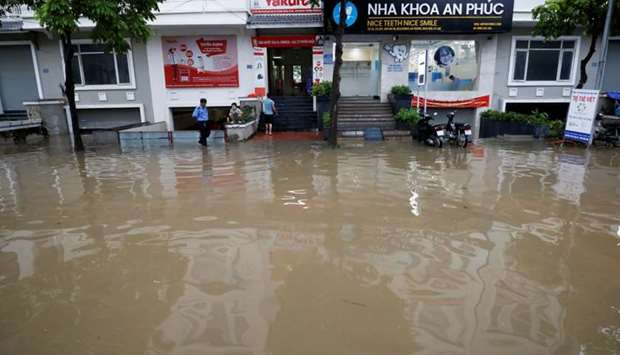 A clinic is seen submerged after Wipha typhoon in Hanoi, Vietnam