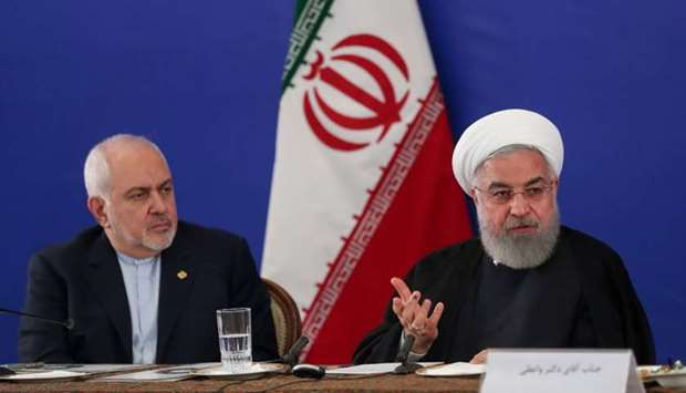 Iranian President Hassan Rouhani speaks during a meeting with Iran's Foreign Minister Mohammad Javad