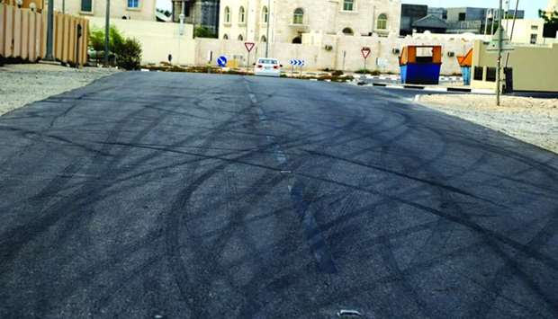 Tyre marks resulting from stunt driving as seen on Al Rekab Street, which comes under Zone 90, and i