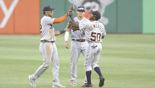 Detroit Tigers left fielder Victor Reyes (22) and centre fielder JaCoby Jones (21) and right fielder
