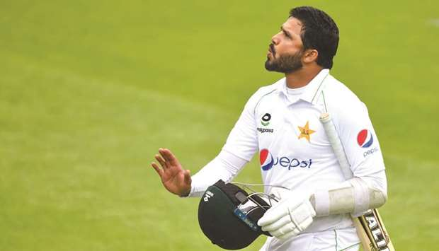 Pakistan's Azhar Ali leaves the field after losing his wicket on the first day of the first Test aga