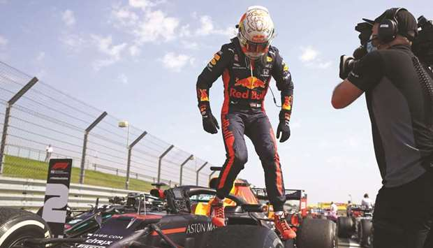Red Bull's Max Verstappen jumps out of his car after winning the 70th Anniversary Grand Prix at Silv