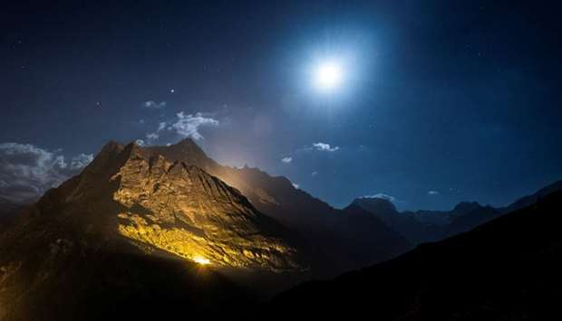 The mountain chains of Veisivi and Dent de Perroc are illuminated by 100 kg of the magnesium powder