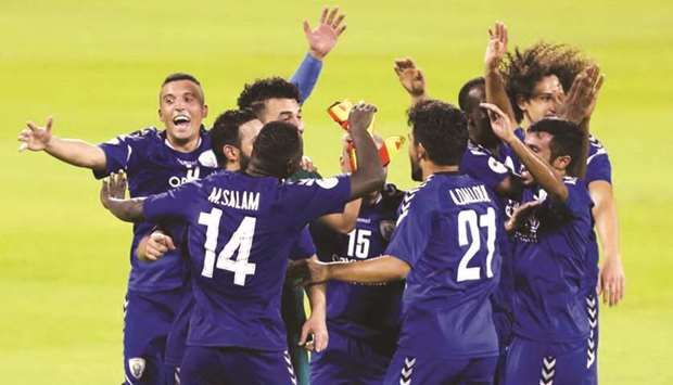 Al Kharaitiyat players celebrate after their promotion to QNB Stars League.