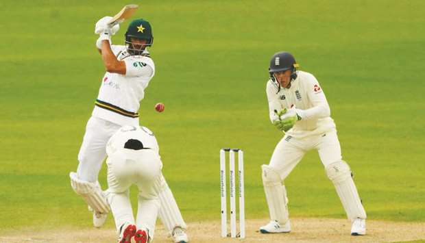 Pakistan's Shan Masood plays a shot on the first day of the first Test against England at Old Traffo