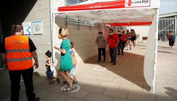 People queue outside a medical center to be tested for the coronavirus disease (COVID-19) in Santa C