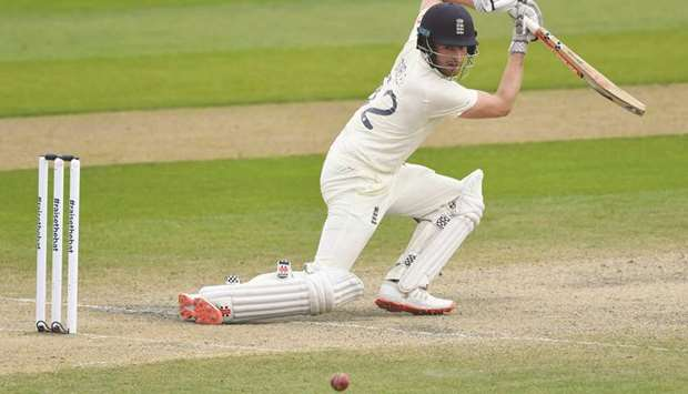 England's Dom Sibley hits a boundary during play on the fourth day of the first Test against Pakista