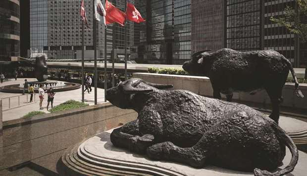 Bull statues displayed outside the Hong Kong Stock Exchange. The Hang Seng closed up 0.2% to 25,284.