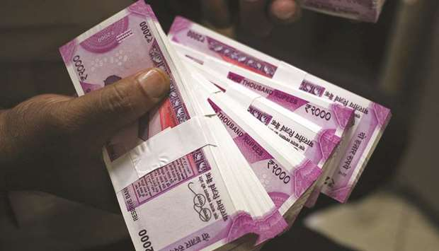The rupee settled 6 paise lower at 74.90 against the US dollar yesterday tracking weak domestic equi