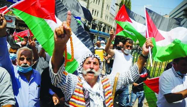 Palestinians take part in a protest against the United Arab Emirates' deal with Israel to normalise