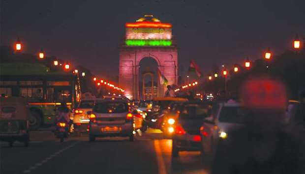 A general view shows traffic in front of the illuminated India Gate on the occasion of the India's 7