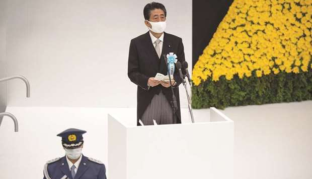 Japan's Prime Minister Shinzo Abe makes a speech during a memorial service marking the 75th annivers