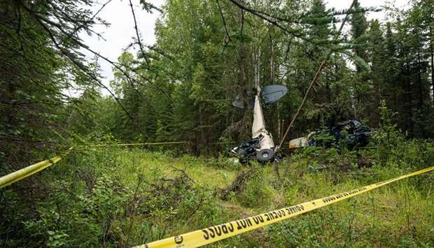 Wreckage the midair collision seen in the woods near the Sterling Highway and Mayoni Street in Soldo