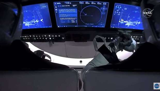 This NASA video frame grab image shows SpaceX's Crew Dragon spacecraft with NASA astronauts Douglas