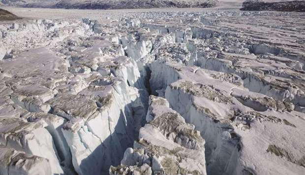 FILE PHOTO: Crevasses form on top of the Helheim glacier near Tasiilaq, Greenland, June 19, 2018. Gi