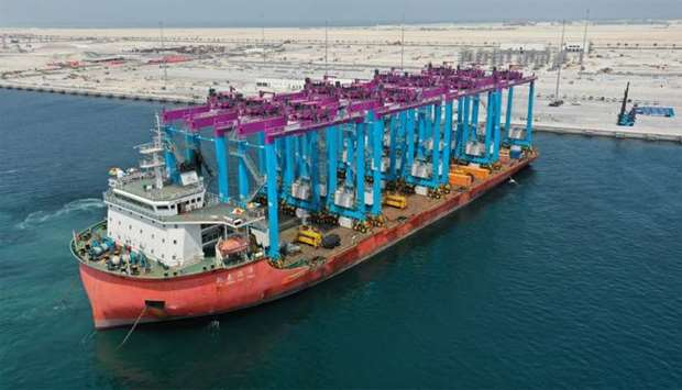 The ship was loaded with rubber-tyred gantry cranes for vertical container transportation.