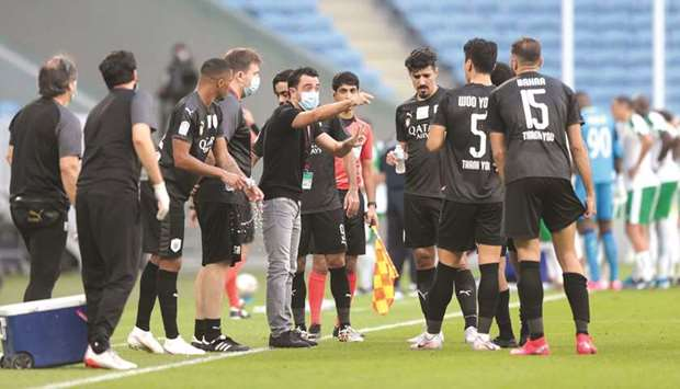 Al Sadd coach Xavi Hernandez gives instructions to his players during the QNB Stars League match aga