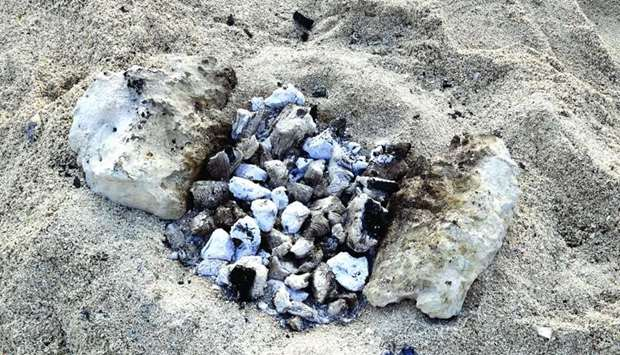 Barbecue remains on the Al Wakra family beach. PICTURE: Ram Chand
