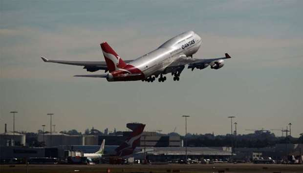 A Boeing Co 747 aircraft operated by Qantas Airways takes off at Sydney Airport (file). With travel