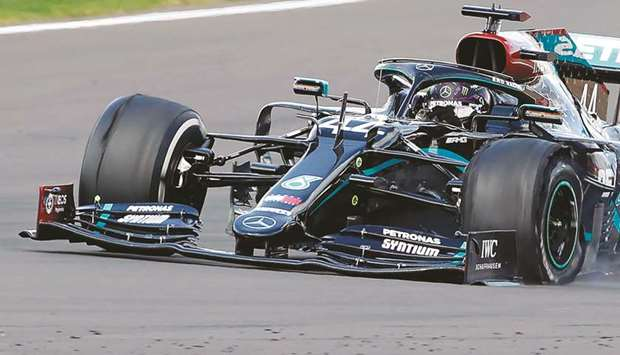 The punctured tyre of Mercedes' driver Lewis Hamilton is pictured as he goes on to win the British G