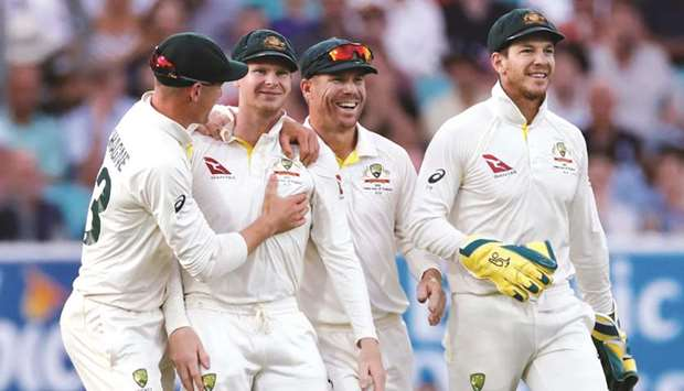In this September 14, 2019, picture, Australia's Steve Smith (second from left) celebrates taking th