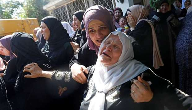 Relatives of Palestinian woman Dalia Smoudi mourn during her funeral in Jenin in the Israeli-occupie