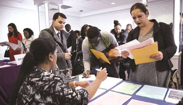 A New York Department of City Administrative Services representative (left), speaks with job seekers