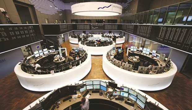 Traders monitor data on computer screens at the Frankfurt Stock Exchange. The DAX 30 closed up 0.7%