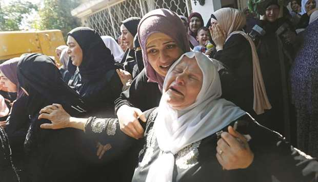 Relatives of Palestinian woman Dalia Samudi, 23, mourn during her funeral in Jenin in the occupied W