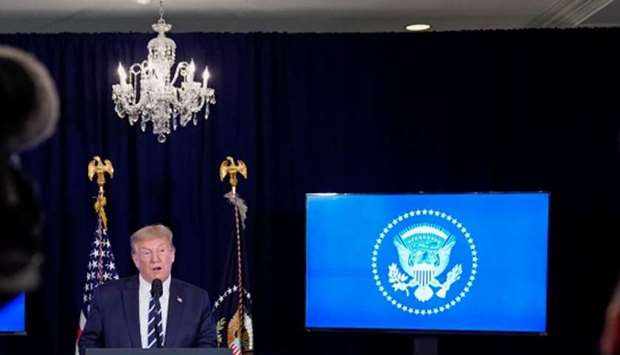 US President Donald Trump speaks during a news conference