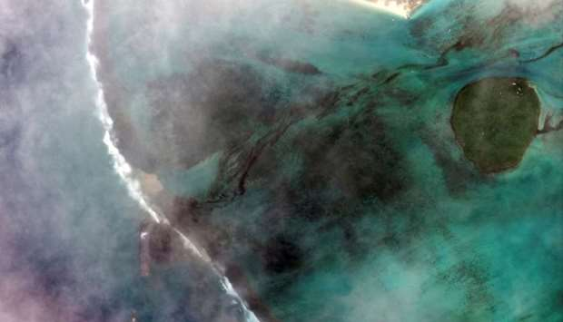 A satellite image shows the bulk carrier ship MV Wakashio and its oil spill after it ran aground off