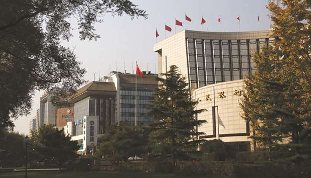 The People's Bank of China headquarters (right) in the financial district of Beijing. China's banks