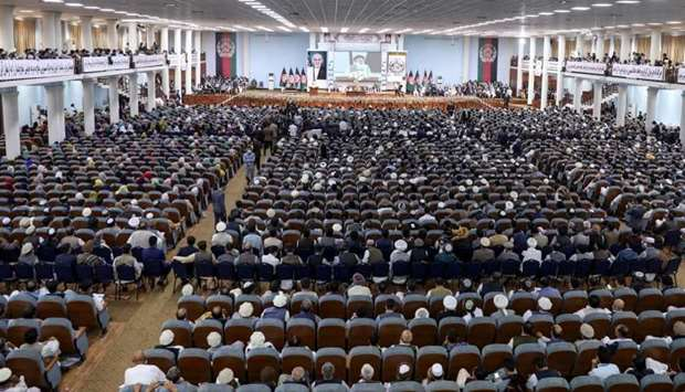 People attend the Loya Jirga, a grand assembly, at the Loya Jirga Hall in Kabul to decide whether to