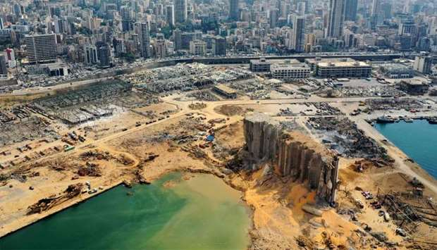 An aerial view shows a partial view of the port of Beirut, the damaged grain silo and the crater cau