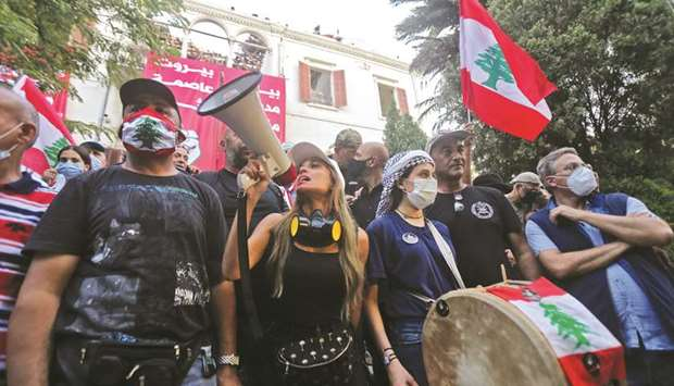Lebanese protesters are pictured inside the Ministry of Foreign Affairs in Beirut yesterday, after p