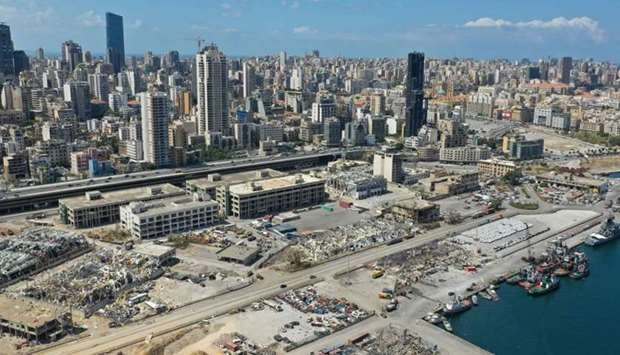 An aerial view shows a partial view of the port of Beirut, damaged as a result of the colossal explo