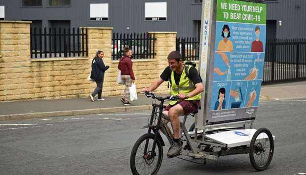 In a promotion funded by Calderdale Council, Phil Mearns rides his ad bike displaying advice on how